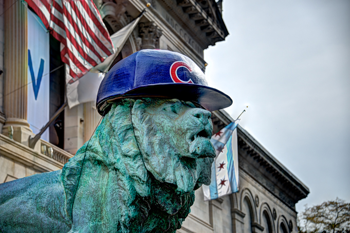 The Art Institute lion proudly wears his new Cubs hat.