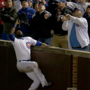 Jason Heyward climbs wall