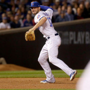 Chicago Cubs third baseman Kris Bryant (17) makes a bad throw to first base in the second inning. (Brian Cassella / Chicago Tribune)