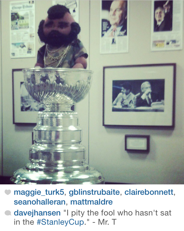 Mr. T sitting in the Stanley Cup, at the Tribune Tower