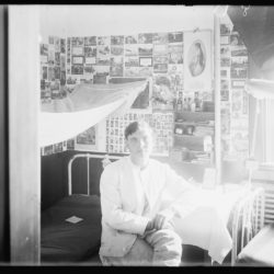 Young man in dormitory room