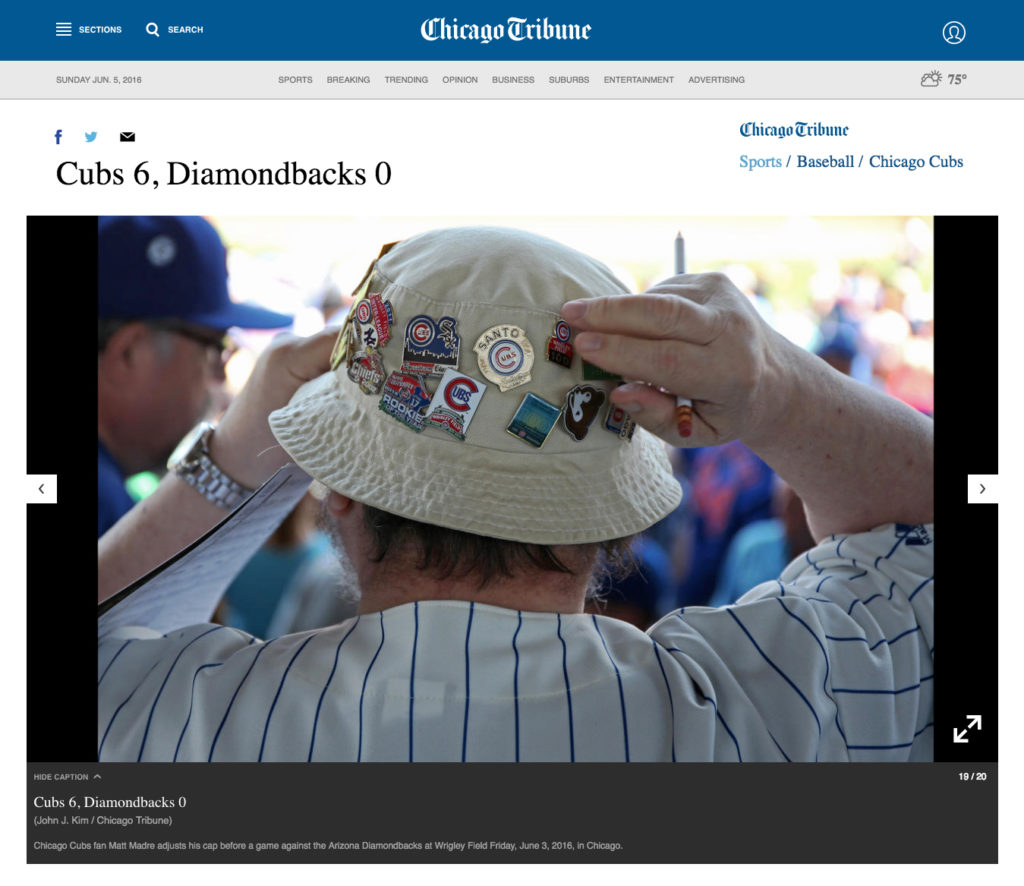 Chicago Cubs fan Mati Maldre adjusts his cap before a game against the Arizona Diamondbacks at Wrigley Field Friday, June 3, 2016, in Chicago. (John J. Kim / Chicago Tribune)