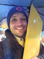 Matt carrying scorecards to the train