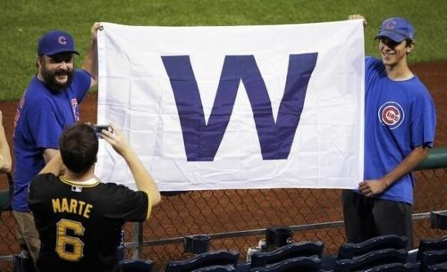 Photo of fans holding W flag at Wrigley Field