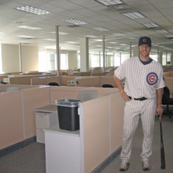 Matt Murton as office worker among the cubicles