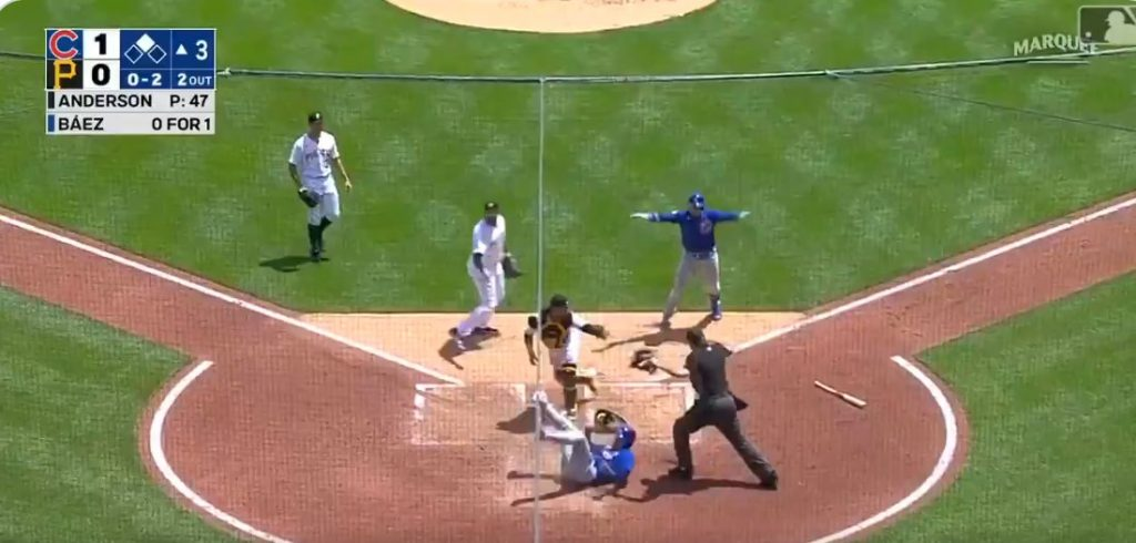 Javier Baez giving the safe sign during his run down.jpg