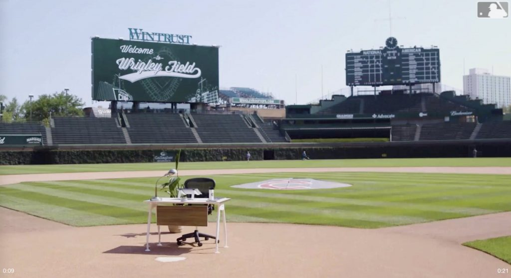 Wide angle shot of Wrigley Field. A work desk is positioned over home plate.